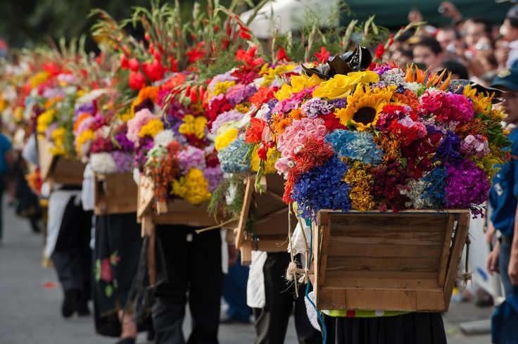 Feria de las Flores is a celebration of Medellín culture that highlights the beauty of flower harvest from surrounding near. El Desfile de Silleteros is a parade where farmers of all ages carry on their backs the integrate flower displays that they have made with their own hands.   #medellin #colombia #inspiration #feriadelasflores2016 #beauty #colors #parade #nature   Ph. via Google