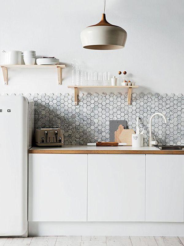 Splash back in honeycomb mosaic; open shelves; light wooden floors; light fitting; clean Smeg retro fridge