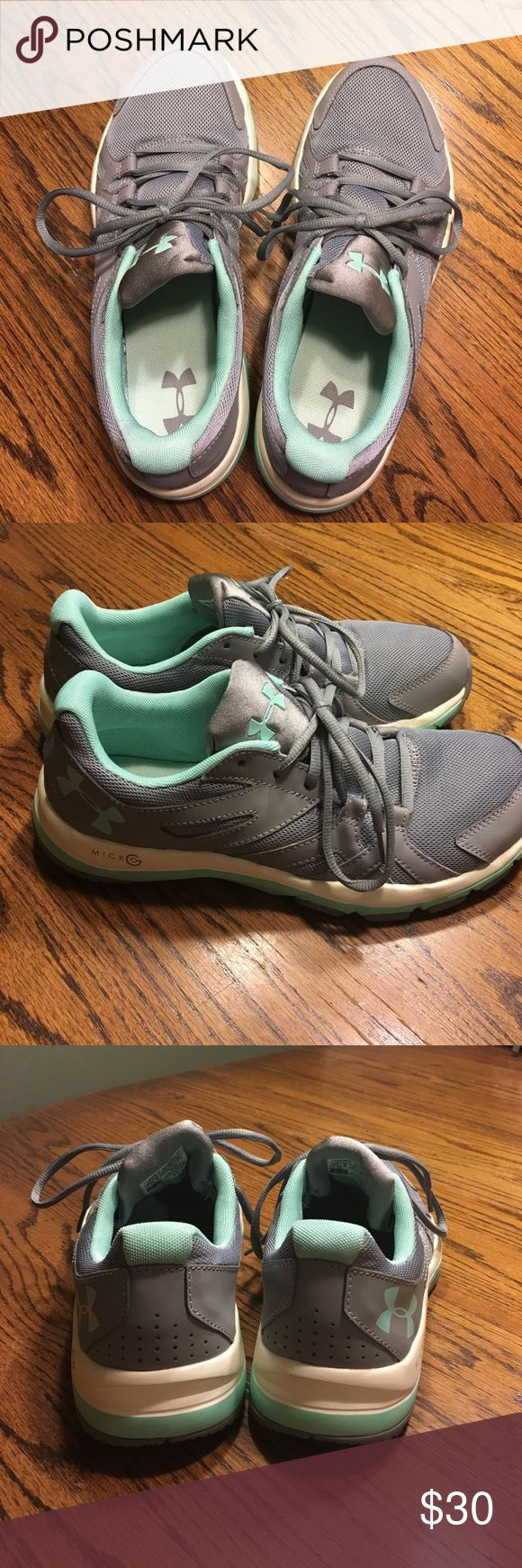 Under Armour tennis shoe Under Armour Grey with aqua trim sneakers. Only been worn around the house to try out.Priced to sale!! Under Armour Shoes Athletic Shoes