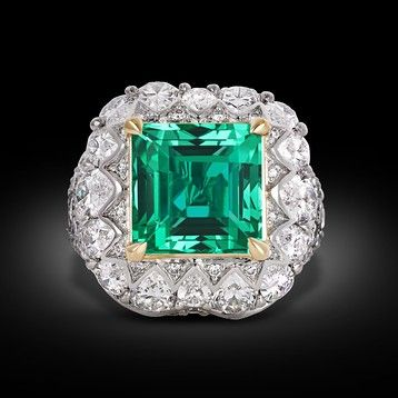 A rare 5.66-carat untreated Colombian emerald smolders in this ring ~ M.S. Rau Antiques