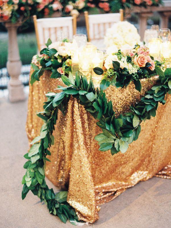 Glamorous table setting draped with greenery #weddingdecor #outdoorwedding #goldwedding #glamwedding #tablescape