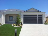 Dubs style custom garage door installed in Melbourne is a comforting style with a single side feature panel which can give a great look with additional windows inserts - Automatic Remote Access