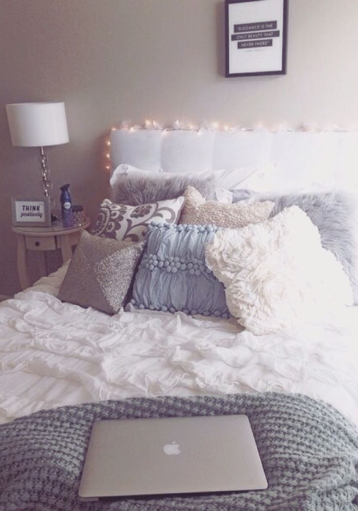 Cozy comfy white bed with colorful pillows