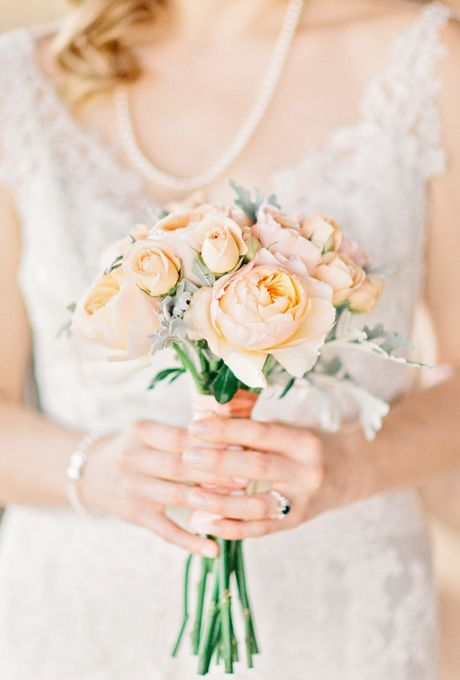 Brides.com: 15 Pretty Peach Bouquets. Bouquet of peach-and-cream garden roses, with dusty miller accents, from Conyers Flower Shop.
