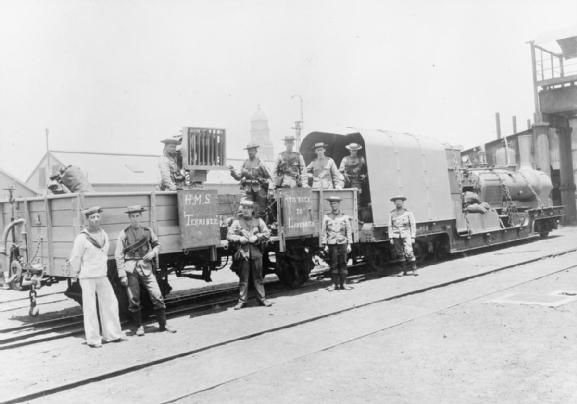 A rare picture of Royal Navy bluejackets of HMS Terrible pose by an armoured train at Durban during the Boer War 1900