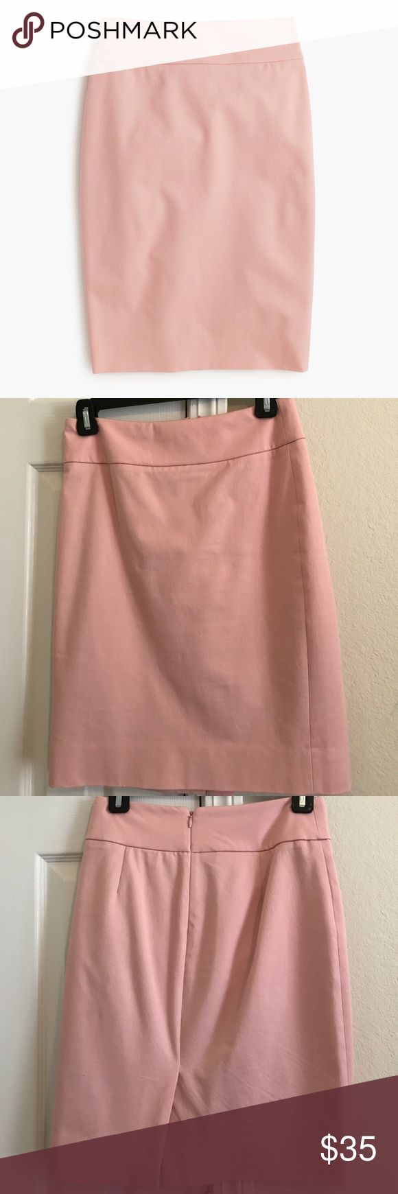 J. Crew Pink Pencil Skirt in Bi-Stretch Cotton No. 2 Pencil Skirt in Bi-Stretch Cotton from J. Crew's suiting line. The light pink color goes great with navy, black, white, green, you name it! Gently used, needs to be ironed but no other flaws. First photo is from J. Crew & the rest are of my item. Dry clean only. Perfect for work! Also selling the same skirt in khaki if you'd like to bundle. J. Crew Skirts Pencil