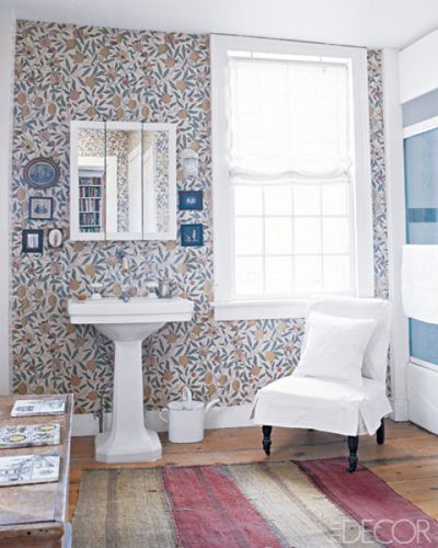 Fruit Wallpaper. In a bathroom of a home in Connecticut, the pedestal sink and fittings are circa 1925 from the Gramercy Park Hotel, and the Fruit wallpaper is by Morris & Co. from Sanderson. Photo by John M Hall