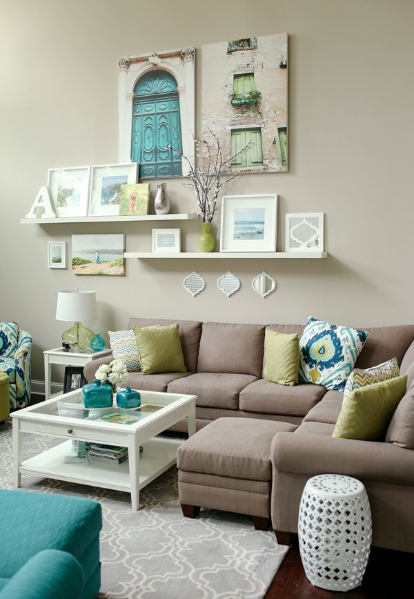 teal + lime living room // love the wall display. Canvases plus shelves.: