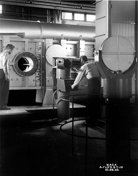 Detail view of Schlieren setup in the 1 x 3 Foot Supersonic Wind Tunnel, 26 October 1945, public domain via Wikimedia Commons.