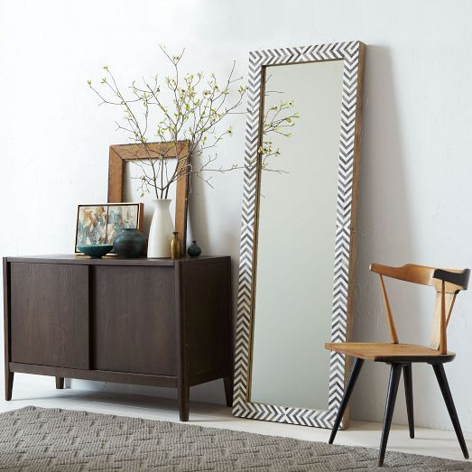 Our popular Parsons Floor Mirror gets a sophisticated new look, now available in a bone inlay frame painted with a cool gray herringbone pattern. It reinterprets the original iconic Parsons design with a simple yet substantial frame that brings dimension and texture to a room.