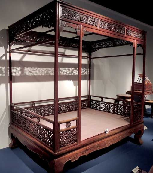 Chinese Ming Dynasty Furniture- Even a bed was not just for sleeping. An adjustable bed made of cane should be light enough to be moved around. A backrest was a must so a scholar could either read books or enjoy the beautiful scenery among trees and flowers. A bed made of wood and bamboo from Hunan was for naps so the scholar could visit Dongting Lake in his dream!
