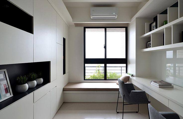 A conducive space to work should encompass some natural light and ample shelving, much like this space.