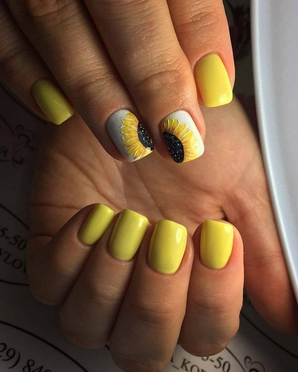 Sun Flower Nail Art Design. Sun flower and yellow, both are associated with the summers. So why not go with these two elements and create your very own stylish yet elegant looking nail art design.