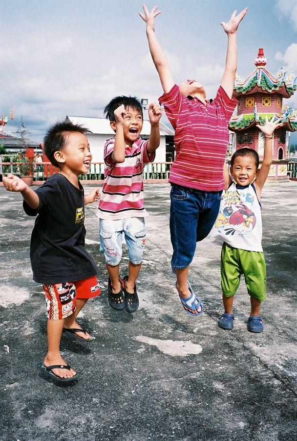 A group of joyful street kids at Hailam Village, Port Klang, Selangor, Malaysia.// by Yeow Chin Liang