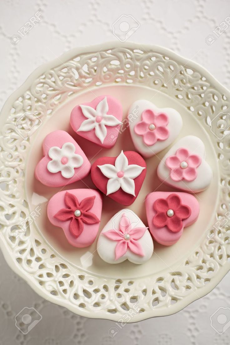 Fondant-covered Petit Fours On Vintage Style Cake Stand Stock ...