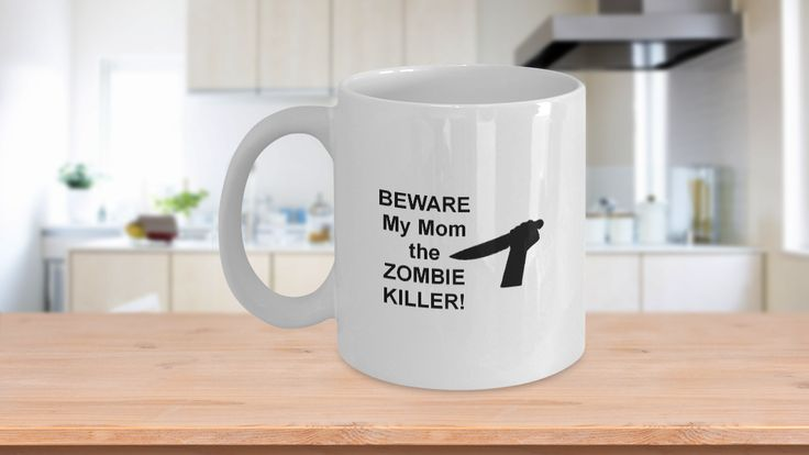 """Do you have one of those zombie lover Moms? This funny coffee mug is just for her - Beware My Mom the ZOMBIE KILLER. Makes the perfect gift for Mother's Day, birthdays, Christmas or even 'just because"""". This funny zombie coffee mug is one of the best zombie gifts for her. Limited Time Only - This itemis NOT available in stores."""