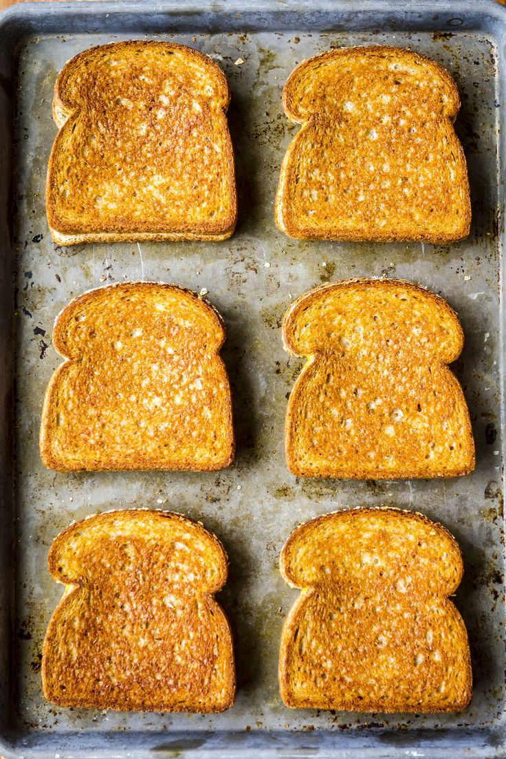 Who knew making grilled cheese in the oven is a thing? It's the perfect method for making big batches of hot & fresh grilled cheese sandwiches for a crowd.