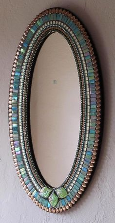 Please see: www.etsy.com/shop/ChrissieDillerCraft for listing for orders.  One of a kind custom mosaic mirror made from individually selected glass tile, hand cut stained glass and beads in a color story you request. The base is wood and sized to order. Please note most any size specification can be accommodated (oval, round, square or rectangular) - options listed are just suggestions. Please message me for costs. Grouted in black (unless requested otherwise), ready to hang. Back has…
