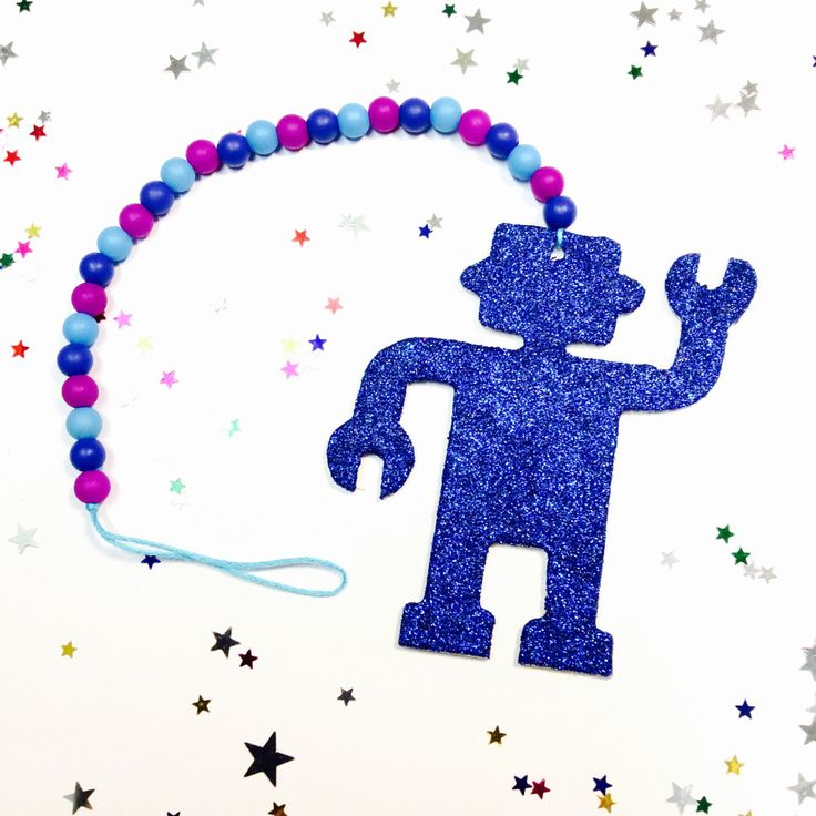 A personal favourite from my Etsy shop https://www.etsy.com/au/listing/483827625/wooden-bead-garland-glitter-robot-art