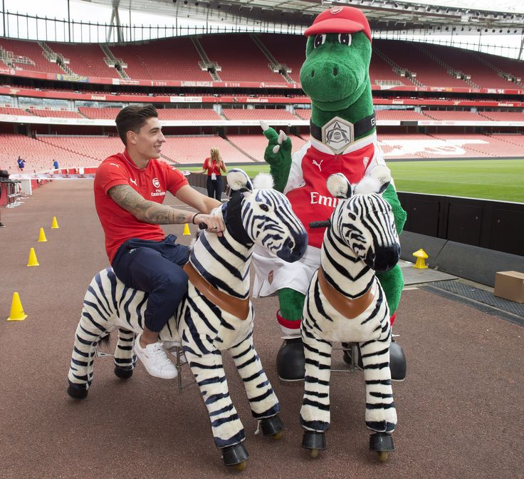 Gunner vs Players! First up are Hector Bellerin and Chuba Akpom. Both have been challenged to race Gunner on a zebra! Watch the video, http://goo.gl/zFT0HL