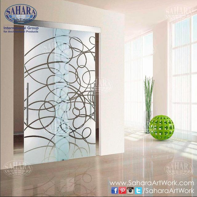 Sliding door frosted glass and clear abstract design, complemented with stainless steel handle and glass accessories.