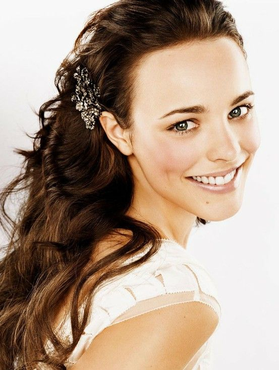 loose waves, pulled back and accented with a big, sparkly brooch clip