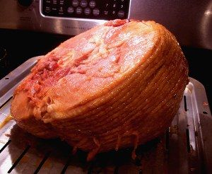 Christmas Honey Glazed Ham-    •1 spiral-sliced, pre-baked Smithfield ham   •1/2 cup orange juice or the juice of 2 oranges   •1/2 cup honey   •1 cup light brown sugar   •1 teaspoon cinnamon