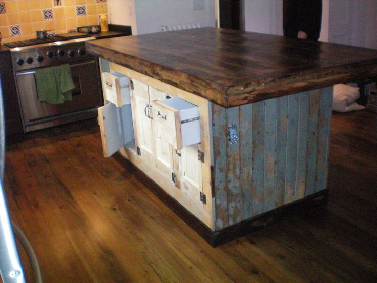 forever interiors large kitchen island with cabinets and drawers made entirely from reclaimed. Black Bedroom Furniture Sets. Home Design Ideas