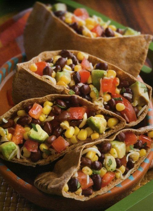 Great lunch or light dinner option: 1 can of black beans, 1 can of corn, 1 ripe avocado chopped up into chunks, 1/2 cup of shredded mozzarella, 1 large tomato diced, 1 small diced red onion, Cilantro, Salt and pepper, 2 Pita Pockets cut length-wise