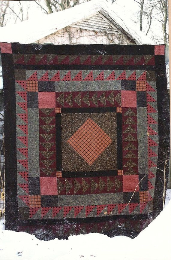 Primitive Folk Art Quilt Pattern  JAKE'S QUILT, a Country Threads design, on etsy,  PrimFolkArtShop. I really like this, the fabrics, colors.