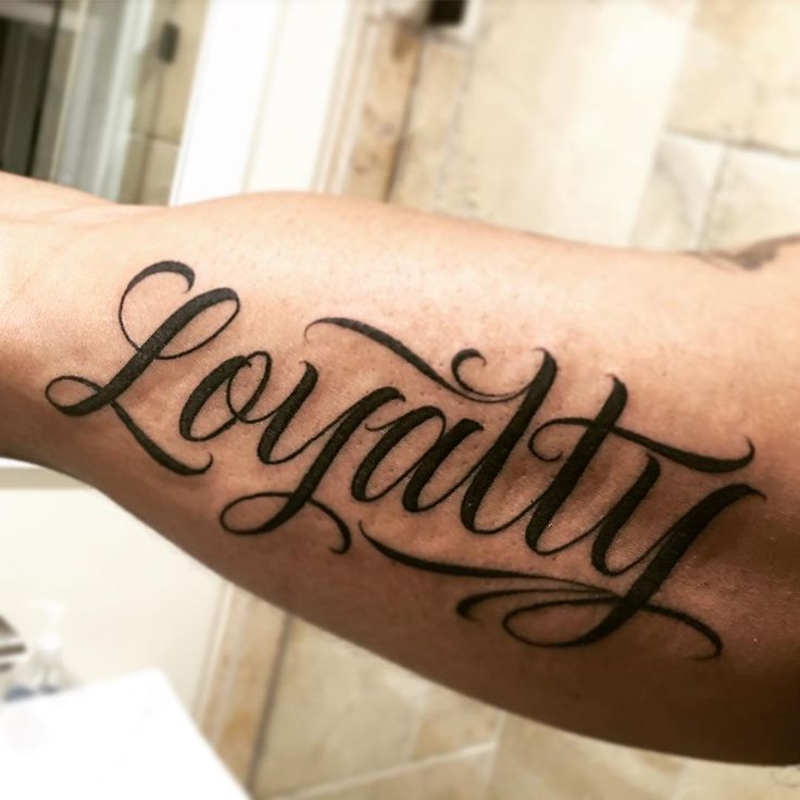 A simple clean one from the other day #script #letteringtattoos #loyalty #tattoo by Saul Lira -- Artist at Under The Gun Tattoo, LA  Saullira@yahoo.com