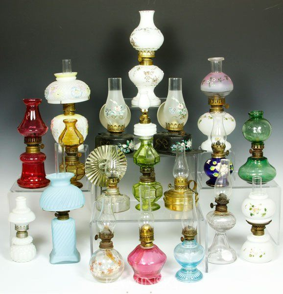 """Collection of twenty miniature oil lamps, to include milk glass, cranberry, brass, pattern glass, cosmos, cobalt, green, 'twinkle', satin glass, """"Improved Banner"""" tole, etc, tallest 11"""" h. - Sold $850"""