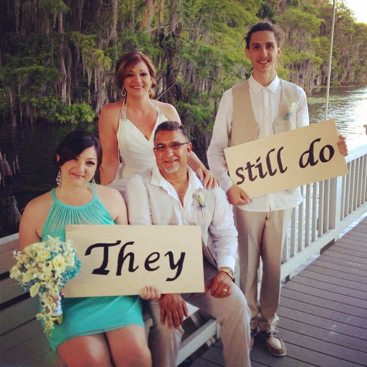 They Still Do | Family Photos | 25th Anniversary Vow Renewal | Paradise Cove | Orlando, FL. | Creative Wedding Signs