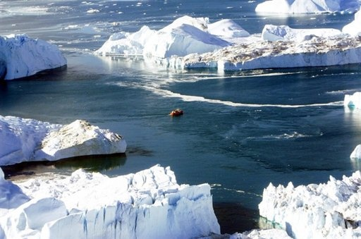 FILE - In this Aug. 17, 2005 file photo, a small boat makes its way through the icebergs in Disko Bay, Greenland. An entire century, two high-profile government investigations and countless books and movies have passed, yet we're still looking for and debating what really caused the Titanic to hit an iceberg and sink on that crystal-clear chilly night.