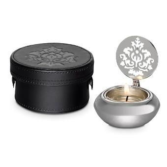 FORBIDDEN FRUITS BY PARTYLITE™ TRAVEL TEALIGHT HOLDER Item: P91624 Dainty silver-tone metal tealight holder comes with its own faux leather travel case. Hinged lid with a pierced damask motif casts a shadow on the wall when lit by a tealight, sold separately. #travelingcandleholder #silverholder #partylitecanada #blackandsilver