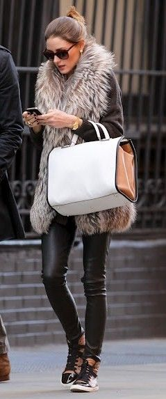 Fur vest with leggings and  large satchel.