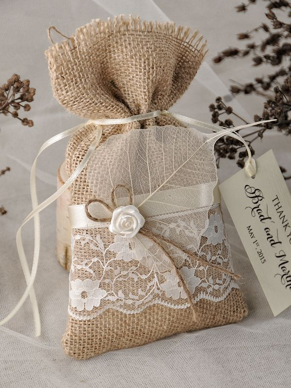 Rustic burlap and lace wedding favour bags, perfect for vintage weddings or country weddings.