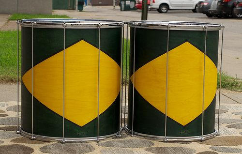 Surdos for Carnival!  Our Tribute to our friends in Brazil (catch the colors--similar to the Brazilian flag). Grab a strap and a mallet and you're ready to set the Batacuda in motion...Now Go Play Some Samba!  22x18, 22x20; plied maple; semi-gloss wax. To see more pix, and search our entire TreeHouse archive for your favorite specs, visit our photo gallery: http://www.flickr.com/photos/treehousedrums/collections/