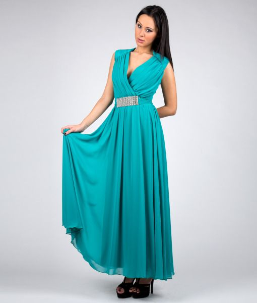 #italianStyle #italianStyle  #wearitalian #madeinitaly Emerald green dress in georgette and satin without sleeves with applied jewel buckle and wide neckline on the front. Suitable for evening wear, for many cerimonies and party.