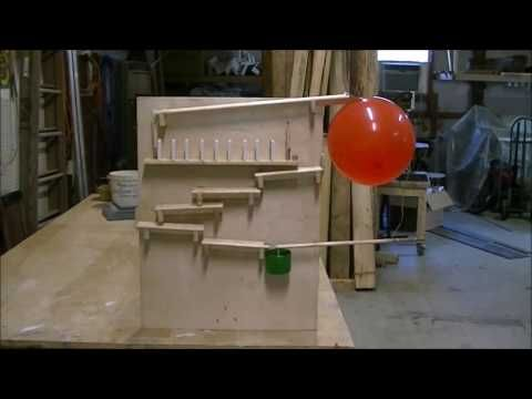 rube goldberg machine, science project. Dominoes falling in slow motions. - YouTube