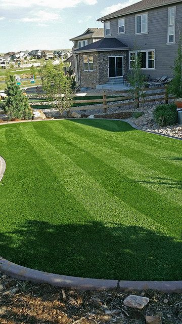 Artificial lawn with concrete edging by plushgrass.com