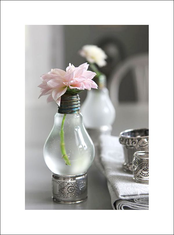 Unique glass centerpieces. Love the flower as well... Anyone know what it is?