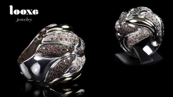 Fireball Anel em Prata com ródio branco e cravação de zircónias champanhe.  // Silver and gold ring with white rhodium and champagne cubic zirconia. // Anillo en plata con rodiado blanco y engastación de circónitas champán.   #looxe #looxejewelry #jewelry #anellooxe #anel #anelemprata #anelemouro #prataeouro #zircónias  #looxe #looxejewelry #jewelry #looxering #ring #ringinsilver #ringingold #silverandgold #stonesetting  P9ANL4569 