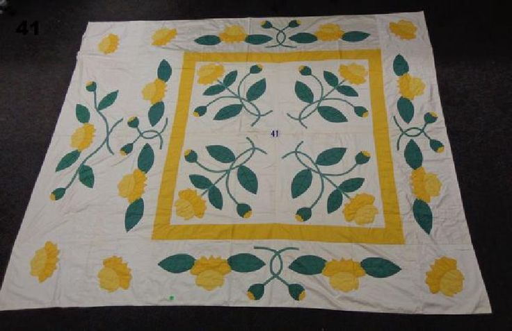ANTIQUE HANDSEWN QUILT WITH FLORAL