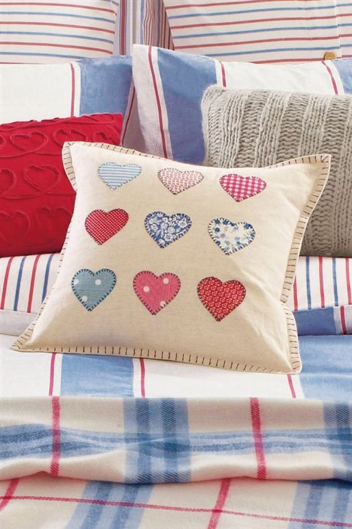Really like the idea of doing a blanket stitch at the edge of the cushion - maybe even add a crochet stitch as an edging