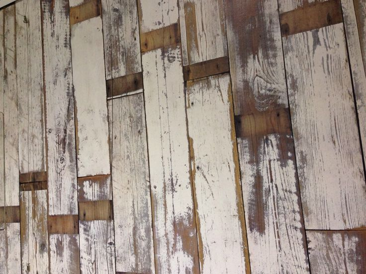 Re purposed timber Floorboard wall feature , this is so raw and rustic looking , i really like the use of the timber here as apposed to your typical brown and dark timbers i find this to be less harsh and hard looking!