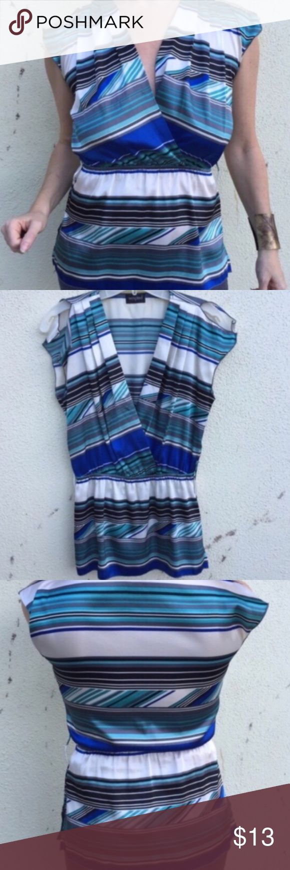striped blouse TOP blouse peplum faux wrap M white Satiny top with stripes, faux wrap neck and elastic waist creating almost a peplum silhouette. Great with straight skirts! Polyester. Fits medium. (F14) Urban Outfitters Tops Blouses