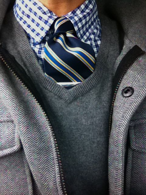 blues and greys: blue striped tie, blue gingham shirt, grey heathered sweater, grey herringbone coat