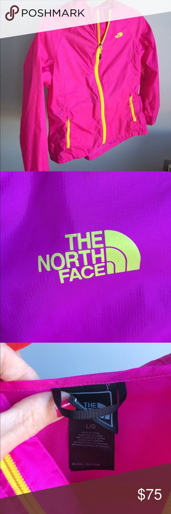 The North Face bright pink packable rain jacket The North Face ladies bright pink with yellow zippers and logo, packable rain jacket! Size Large The North Face Jackets & Coats