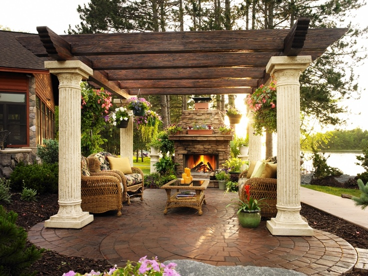 THIS LOOKS LIKE YOUR VIEW. LOVE THE SALVAGED COLUMNS ON PERGOLA. OUT DOOR FP! GREAT.